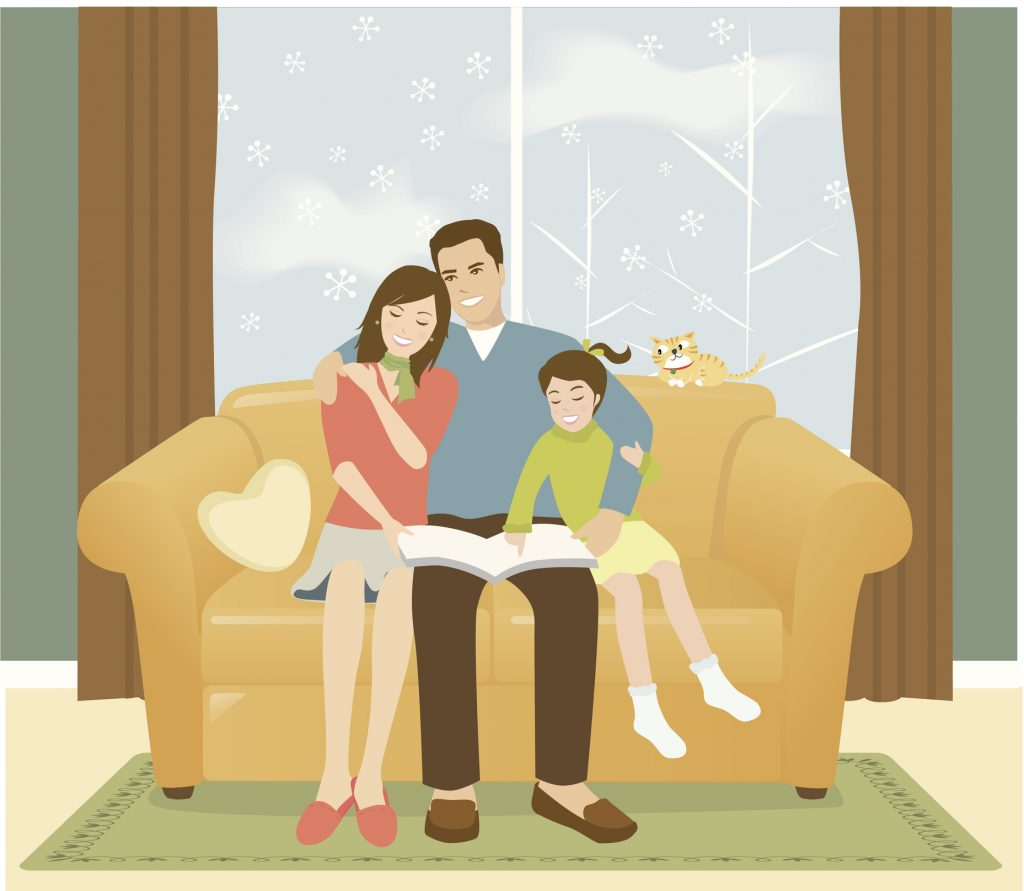 Portrait of Family Reading on Couch