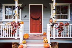 Halloween pumpkins and decorations outside a Portland house