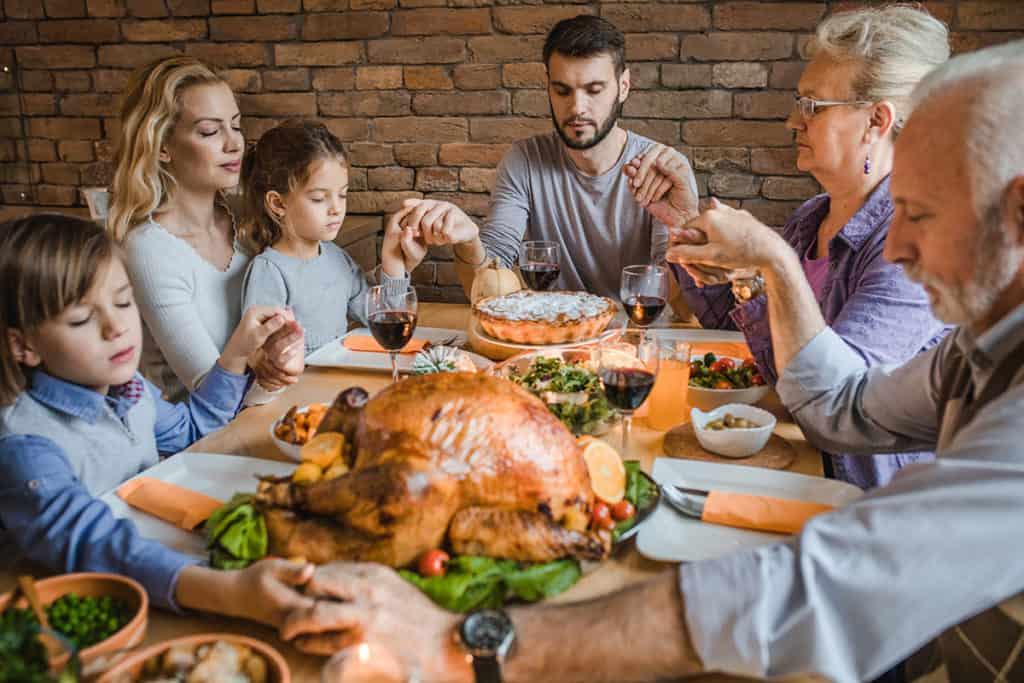 family giving thanks