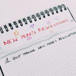 A notebook with New Year's Resolutions written on the top. #1 Quit Making New Year's Resolutions.
